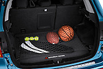 Rear cargo hatchback area of a 2011 Mitsubishi Outlander Sport SE with props