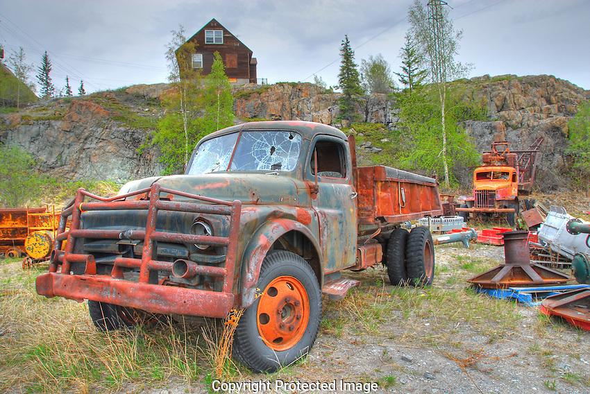 Trucks in old equipment graveyard, Giant minesite, Yellowknife.