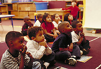 YOUNG ELEMENTARY SCHOOL STUDENTS LISTENING CAREFULLY. ELEMENTARY STUDENTS. OAKLAND CALIFORNIA USA CARL MUNCK ELEMENTARY SCHOOL.