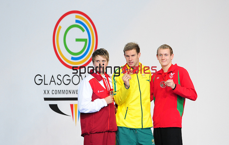 The podium for the men's para-sport 200m freestyle S14 final, from left, silver medalist England's Hamer Thomas, gold medalist Australia's Daniel Fox and bronze medalist Wales' Jack Thomas<br /> <br /> Photographer Chris Vaughan/Sportingwales<br /> <br /> 20th Commonwealth Games - Day 3 - Saturday 26th July 2014 - Swimming - Tollcross International Swimming Centre - Glasgow - UK