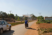 Pará State, Brazil. The town of Tucumã. Transporting a large satellite television dish by motorbike!