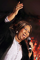 NEW YORK - DECEMBER 04: Aretha Franklin performs at the 85th annual New York Stock Exchange Christmas tree lighting ceremony on Wall Street, New York City. December 4, 2008<br /> <br /> People:  Aretha Franklin