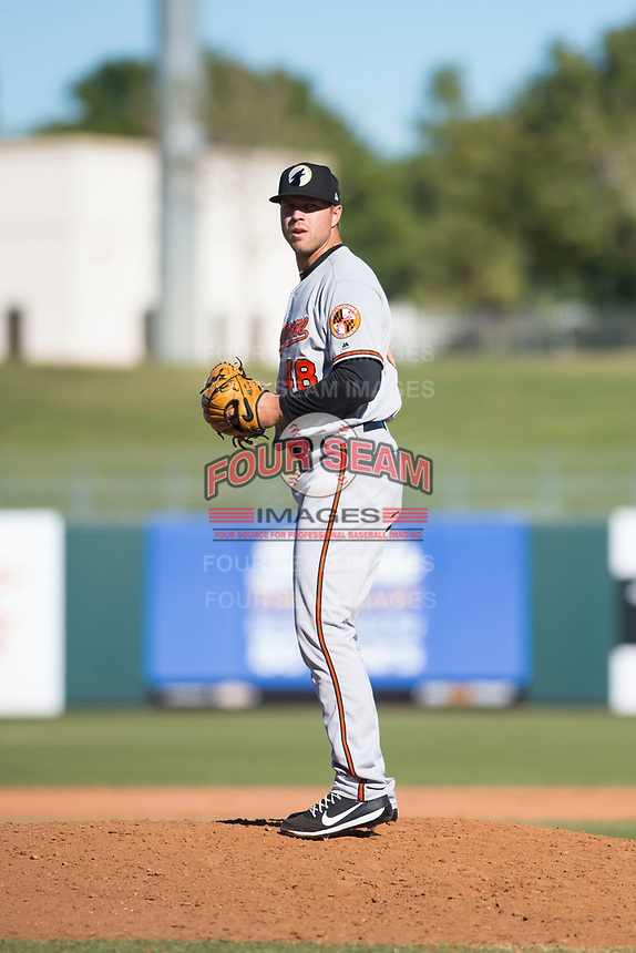 Glendale Desert Dogs relief pitcher Jay Flaa (48), of the Baltimore Orioles organization, gets ready to deliver a pitch during an Arizona Fall League game against the Surprise Saguaros at Surprise Stadium on November 13, 2018 in Surprise, Arizona. Surprise defeated Glendale 9-2. (Zachary Lucy/Four Seam Images)