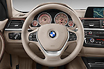 Steering wheel view of a 2012 - 2014 BMW 3-Series 320d Modern 4 Door Sedan.