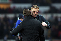 SWANSEA, WALES - MARCH 16: Liverpool manager Brendan Rodgers embraces Swansea manager Garry Monk after the Premier League match between Swansea City and Liverpool at the Liberty Stadium on March 16, 2015 in Swansea, Wales