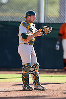 Oakland Athletics catcher Max Kuhn (11) during an Instructional League game against the San Francisco Giants on October 13, 2014 at Giants Baseball Complex in Scottsdale, Arizona.  (Mike Janes/Four Seam Images)