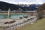 Tour of the Alps UCI Cycling Race. Resia, Imst, Italy on April 21, 2021.  Stage 3 from Imst Austria to Naturns/Naturno, the peloton in Front of Resia Lake and Church Bell.
