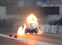 Sep 28, 2019; Madison, IL, USA; NHRA funny car driver Tim Wilkerson explodes the engine of his car on fire during qualifying for the Midwest Nationals at World Wide Technology Raceway. Wilkerson would be uninjured in the incident. Mandatory Credit: Mark J. Rebilas-USA TODAY Sports