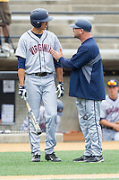 Virginia Cavaliers associate head coach Kevin McMullan (right) gives instructions to Daniel Pinero (22) during the game against the Wake Forest Demon Deacons at Wake Forest Baseball Park on May 17, 2014 in Winston-Salem, North Carolina.  The Demon Deacons defeated the Cavaliers 4-3.  (Brian Westerholt/Four Seam Images)