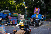 """New York, New York<br /> July 15, 2020<br /> <br /> Occupy City Hall is an activist encampment outside New York City's. City Hall and the last  wave of the city's George Floyd protests. It's an innovative political space that attracted peaceful crowds to speeches and teach-ins focused on a narrow goal: cutting $1 billion from the New York Police Department's budget.<br /> <br /> Volunteers flocked to the park, dropping off food, coffee and supplies to build a kind of campground. However, the number of protesters has dropped sharply.<br /> <br /> Passers-by and journalists have been harassed. Local residents — even those who say they support the camp's politics — have complained that it has turned into a disorderly shantytown where violence has occurred. Several medics who had been there from the start announced this week that they were leaving, citing """"a lack of safety"""" in a statement."""