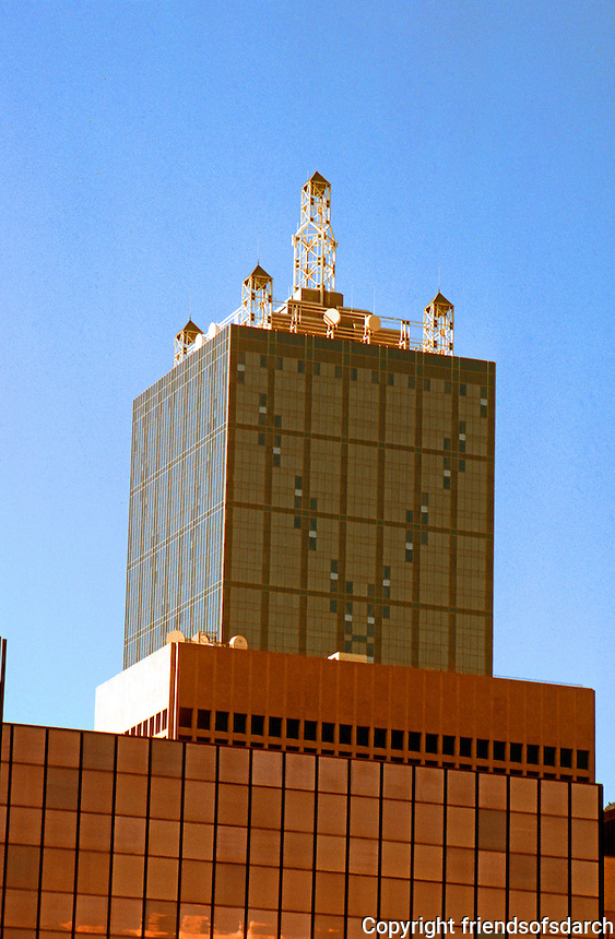 Dallas: Renaissance Tower in back of other building, 1974.  Broadcast center and towers on top. 56 story modernist skyscraper. Designed by HOK and renovated by S-O-M in 1986. Photo 1996.