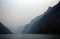 CHINA. Hubei Province. A view of the 3 Gorges.  The flooding of the three Gorges, by damming the Yangtze near the town of YiChang, has remained a controversial subject due to the negative environmental consequences and the displacement of millions of people in the flood plain. The Yangtze River however is reported to be at its lowest level in 150 years as a result of a country-wide drought. It is China's longest river and the third longest in the world. Originating in Tibet, the river flows for 3,964 miles (6,380km) through central China into the East China Sea at Shanghai.  2008.