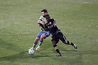 COLUMBUS, OH - DECEMBER 12: Jonathan Mensah #4 of the Columbus Crew and Will Bruin #17 of the Seattle Sounders FC challenge for the ball during a game between Seattle Sounders FC and Columbus Crew at MAPFRE Stadium on December 12, 2020 in Columbus, Ohio.