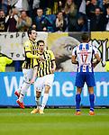 Nederland, Arnhem, 31 mei 2015<br /> Seizoen 2014-2015<br /> Play-offs voor voorronde Europa League<br /> Vitesse-SC Heerenveen (5-2)<br /> Marko Vejinovic van Vitesse balt zijn vuist nadat hij een doelpunt heeft gemaakt. Links Valeri Qazaishvili van Vitesse en rechts Luciano Slagveer van SC Heerenveen