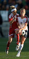 Kelly Parker, Heather O'Reilly. The US Women's National Team defeated the Canadian Women's National Team, 4-0, at BMO Field in Toronto during an international friendly soccer match on May 25, 2009.