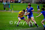 Dan O'Shea of Ballymac bearing down on the Annascaul goalmouth and under pressure from Annascaul's Gearoid Lyne in Division 2b of the County Football League