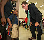 Houston ISD Superintendent Dr. Terry Grier talks with a young student on the first day of classes at Marshall Elementary School, August 26, 2013.