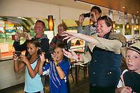 August 24, 2014, Netherlands, Amstelveen, De Kegel, National Veterans Championships, Prizegiving, Family and friend making pictures<br /> Photo: Tennisimages/Henk Koster