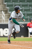 J.D. Martinez #20 of the Lexington Legends flips his bat as he heads towards first base against the Kannapolis Intimidators at Fieldcrest Cannon Stadium April 14, 2010, in Kannapolis, North Carolina.  Photo by Brian Westerholt / Four Seam Images