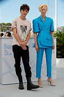 """CANNES, FRANCE - JULY 13:  Timothée Chalamet and British actress Tilda Swinton at photocall for the film """"The French Dispatch"""" at the 74th annual Cannes Film Festival in Cannes, France on July 13, 2021 <br /> CAP/GOL<br /> ©GOL/Capital Pictures"""