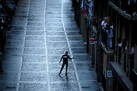 Shephart walks down the Estafeta street before the first bull run of the Alcurrucen's bulls of the San Fermin Festival, on July 7, 2013, in Pamplona, northern Spain. The festival is a symbol of Spanish culture that attracts thousands of tourists to watch the bull runs despite heavy condemnation from animal rights groups. (c) PEDRO ARMESTRE