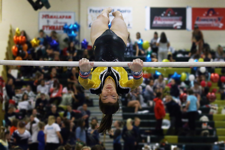 Caroline Larkin from St. John Vianney High School makes her way across the bars during the uneven bars during the Shore Conference Gymnastics 2017 Championships held at Brick Memorial High School in Brick on Saturday October 28, 2017