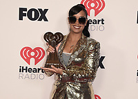 """HOLLYWOOD, CA - MAY 27:  H.E.R. with the award for R&B Artist of the Year at the 2021 """"iHeartRadio Music Awards"""" airing live from The Dolby Theatre in Los Angeles, Thursday, May 27 (8:00-10:00 PM ET live / PT tape-delayed) on FOX. CR: Scott Kirkland/FOX/PictureGroup © 2021 FOX MEDIA, LLC. (Photo by Scott Kirkland/FOX/PictureGroup)"""