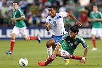 Luis Garrido (19) Honduras and Alan Pulido (19) Mexico fight for the ball... Mexico defeated Honduras 2-1 after extra time to win the CONCACAF Olympic qualifying trophy at LIVESTRONG Sporting Park, Kansas City, Kansas.