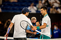 18th February 2021, Melbourne, Victoria, Australia; Novak Djokovic of Serbia meets with Aslan Karatsev of Russia after winning his match during the semifinals of the 2021 Australian Open on February 18 2021, at Melbourne Park in Melbourne, Australia.