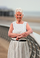 COPY BY TOM BEDFORD<br /> Pictured: Pat Stewart at Blackpool Promenade.<br /> Re: A pin-up girl from the 1950s has returned to the spot where she accidentally flashed her knickers and won the nation's hearts.<br /> Pat Stewart was a teenage dancer when she and a pal were persuaded to pose for a picture on Blackpool seafront.<br /> As the camera clicked a gust of wind lifted her skirt to give just a glimpse of forbidden flesh.<br /> Pat became known as the girl in the spotty dress and it helped kick-off her showbusiness career.<br /> And 65 years later Pat posed on the same spot after returning to Blackpool for the first time since the saucy snap was taken.£150 MINIMUM FOR NEWSPAPER USE PLEASE