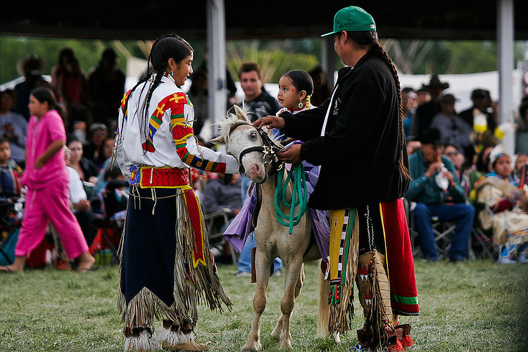 A family shares a young dancers winning prize.