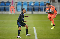 SAN JOSE, CA - SEPTEMBER 16: Steve Clark #12 of the Portland Timbers grabs a ball in front of Chris Wondolowski #8 of the San Jose Earthquakes during a game between Portland Timbers and San Jose Earthquakes at Earthquakes Stadium on September 16, 2020 in San Jose, California.