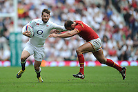 Elliot Daly of England attempts to had off Jamie Roberts of Wales during the Old Mutual Wealth Cup match between England and Wales at Twickenham Stadium on Sunday 29th May 2016 (Photo: Rob Munro/Stewart Communications)