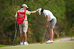 CHON BURI, THAILAND - FEBRUARY 17:  Juli Inkster of USA practices with her caddie on the 17th hole during day one of the LPGA Thailand at Siam Country Club on February 17, 2011 in Chon Buri, Thailand. Photo by Victor Fraile / The Power of Sport Images