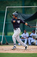 GCL Yankees West center fielder Antonio Arias (12) follows through on a swing during the second game of a doubleheader against the GCL Braves on July 30, 2018 at Champion Stadium in Kissimmee, Florida.  GCL Braves defeated GCL Yankees West 5-4.  (Mike Janes/Four Seam Images)