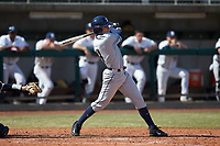 Conor Grammes (4) of the Xavier Musketeers follows through on his swing against the Penn State Nittany Lions at Coleman Field at the USA Baseball National Training Center on February 25, 2017 in Cary, North Carolina. The Musketeers defeated the Nittany Lions 10-4 in game one of a double header. (Brian Westerholt/Four Seam Images)