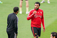 Watford caretaker manager Hayden Mullins and Troy Deeney of Watford during the Premier League match between Watford and Manchester City at Vicarage Road, Watford, England on 21 July 2020. Football Stadiums around remain empty due to the Covid-19 Pandemic as Government social distancing laws prohibit supporters inside venues resulting in all fixtures being played behind closed doors until further notice.<br /> Photo by Andy Rowland.