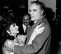 Gina Lollobrigida (L), Serge Losique (R) at Italian week, The Bay store on Oct 1985 <br /> <br /> File Photo :  Agence Quebec Presse - Pierre Roussel