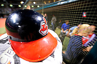 4 September 2009: A Cleveland Indians batting helmet rests outside the dugout after a game against the Minnesota Twins at Progressive Field in Cleveland, Ohio. The Indians defeated the Twins 5-2 to take the first game of their three-game weekend series. Mandatory Credit: Ed Wolfstein Photo