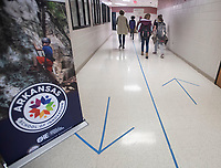Directional markers on the floor directs student traffic flow Thursday Dec. 17, 2020 at Lincoln Middle School. Visit nwaonline.com/201227Daily/ and nwadg.com/photos. (NWA Democrat-Gazette/J.T. Wampler)