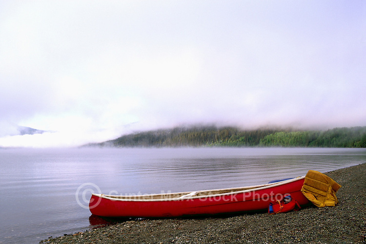 Red Canoe on Shore of Bowron Lake, Bowron Lake Provincial Park, BC, Cariboo Region of British Columbia, Canada