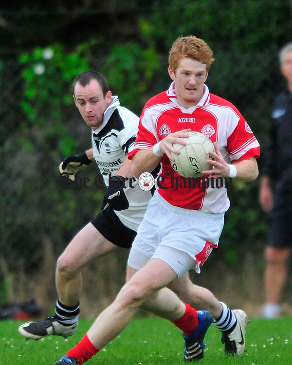 Eire Og's Brendan Manning takes posession ahead of Ennistymon's Wayne Griffin. Photograph by Declan Monaghan.
