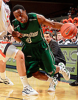 CHARLOTTESVILLE, VA- NOVEMBER 26:  Steve Baker #4 of the Green Bay Phoenix handles the ball during the game on November 26, 2011 at the John Paul Jones Arena in Charlottesville, Virginia. Virginia defeated Green Bay 68-42. (Photo by Andrew Shurtleff/Getty Images) *** Local Caption *** Steve Baker