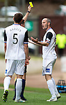St Johnstone v Inverness Caley Thistle...02.05.15   SPFL<br /> David Raven is booked by Ref Andrew Dallas in the first half for an incident with Murray Davidson<br /> Picture by Graeme Hart.<br /> Copyright Perthshire Picture Agency<br /> Tel: 01738 623350  Mobile: 07990 594431