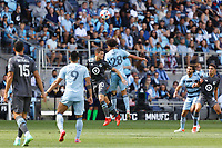 ST. PAUL, MN - AUGUST 21: Cameron Duke #28 of Sporting Kansas City and Wil Trapp #20 of Minnesota United FC go for the header during a game between Sporting Kansas City and Minnesota United FC at Allianz Field on August 21, 2021 in St. Paul, Minnesota.