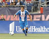 Philadelphia Union midfielder Daniel Cruz (44) on the attack.  In a Major League Soccer (MLS) match, the New England Revolution (dark blue) defeated Philadelphia Union (light blue), 5-1, at Gillette Stadium on August 25, 2013.