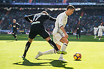 Cristiano Ronaldo of Real Madrid battles for the ball with Ruben Miguel Nunes Vezo of Granada CF during their La Liga match between Real Madrid and Granada CF at the Santiago Bernabeu Stadium on 07 January 2017 in Madrid, Spain. Photo by Diego Gonzalez Souto / Power Sport Images