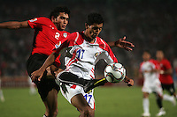 Egypt's Salah Soliman (2) makes a leaping kick against Costa Rica's Josue Martinez (17) during the FIFA Under 20 World Cup Round of 16 match between Egypt and Costa Rica at the Cairo International Stadium on October 06, 2009 in Cairo, Egypt.