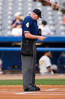 Home plate umpire Chad Whitson looks over the line up cards prior to the Eastern League contest between the Trenton Thunder and the Connecticut Defenders at Dodd Stadium in Norwich, CT, Tuesday, June 3, 2008.