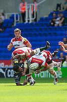 Nick Wood of Gloucester Rugby checks on Ofisa Treviranus of London Irish after a big tackle with Tom Savage of Gloucester Rugby (left) during the Aviva Premiership match between London Irish and Gloucester Rugby at the Madejski Stadium on Saturday 8th September 2012 (Photo by Rob Munro)